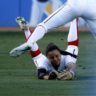 Arizona's Ashleigh Hughes dives for a ball on may 25,