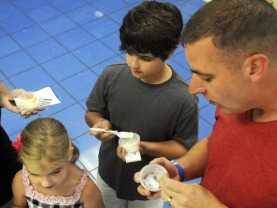 A file photo of a family enjoying ice cream during a past Scoop-a-Palooza during ChambersFest.
