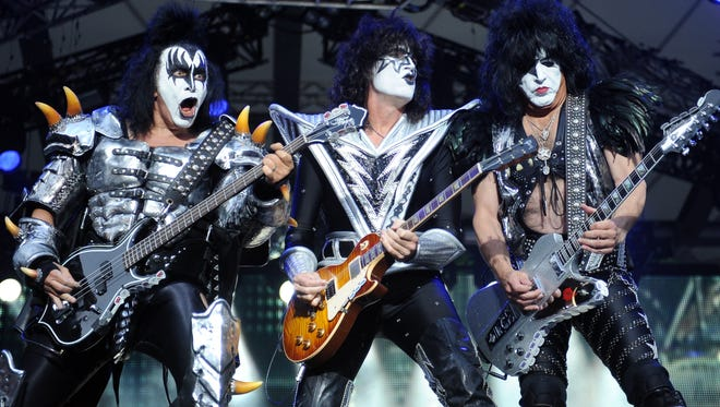 Bassist Gene Simmons, left, guitarist Tommy Thayer and singer Paul Stanley of Kiss perform in Berlin in June 2013.