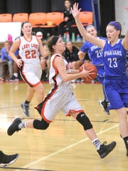 Ashley Robertson drives for Lucas in its win over St. Peter's.