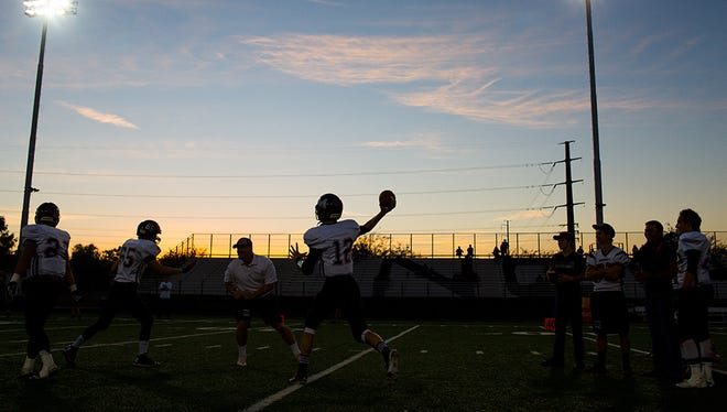 The Mogollon football team warms up before the Division VI high school football state championship game against Bagdad High School on November 15, 2014 in Phoenix.