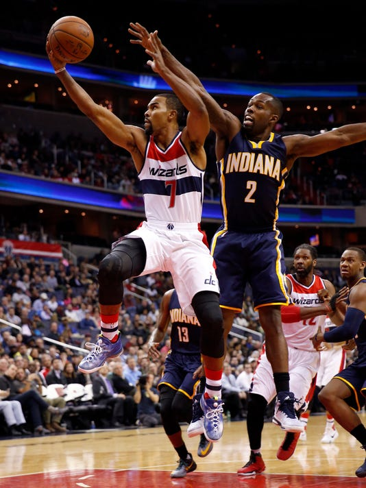 Washington Wizards guard Ramon Sessions (7) shoots in front of Indiana Pacers guard Rodney Stuckey (2) during the first half of an NBA basketball game Tuesday, Nov. 24, 2015, in Washington. (AP Photo/Alex Brandon)