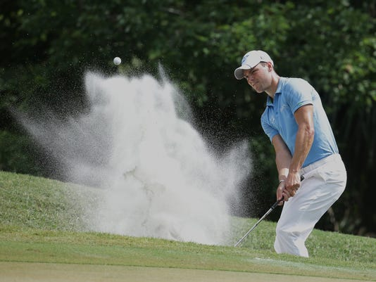 Martin Kaymer of Germany, hits from a sand bunker on the eighth hole during the second round of The Players Championship golf tournament Friday, May 13, 2016, in Ponte Vedra Beach, Fla. (AP Photo/Lynne Sladky)