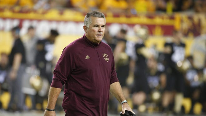 Arizona State Sun Devils head coach Todd Graham walks back to the bench after checking on an injured player during an football game against the Colorado Buffaloes at Sun Devil Stadium in Tempe on November 4, 2017.
