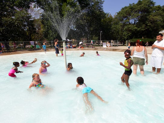 Kids cool off at the Humboldt Park wading pool.