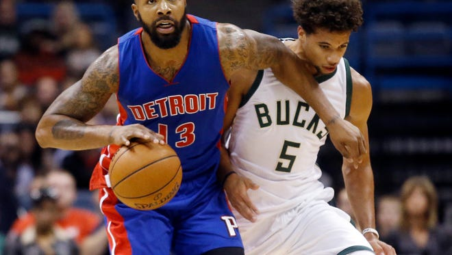 Detroit Pistons' Marcus Morris (13) drives past Milwaukee Bucks' Michael Carter-Williams (5) during the first half. Morris scored 21 as the Pistons defeated the Bucks,  117-88, Saturday for their first preseason victory.