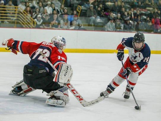 Chenango Forks' goalie Josh Black reacts to Binghamton's