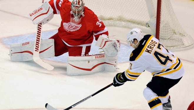 Red Wings goalie Petr Mrazek prepares to block the shot of Bruins defenseman Torey Krug (47) during the first period of an NHL hockey game in Detroit, Saturday, Sept. 26, 2015.