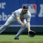 Detroit Tigers second baseman Ian Kinsler fields a ball hit by Kansas City Royals' Mike Moustakas during the first inning of a baseball game at Kauffman Stadium in Kansas City, Mo., Sunday. Moustakas was out at first base on the play.