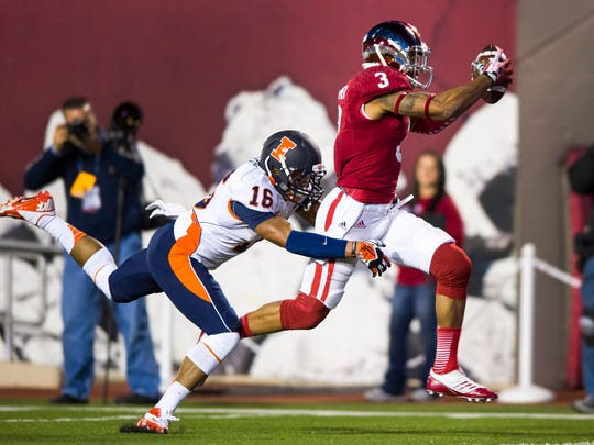 Indiana's Cody Latimer (3) runs into the end zone to score as Illinois' Caleb Day (16) reaches out in an effort to pull him down, Nov. 9, 2013.