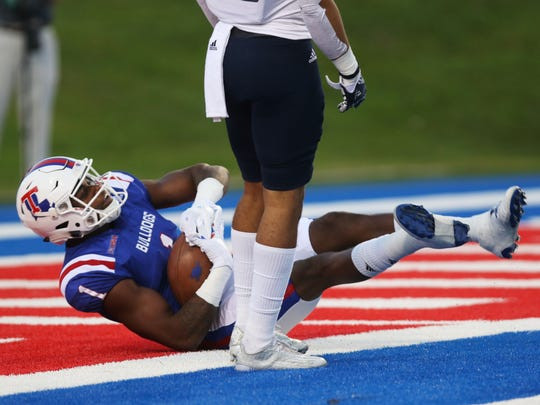Louisiana Tech wide receiver Carlos Henderson falls backwards into the endzone as he scores the first touchdown of the Bulldogs' home game against Rice University at Joe Aillet Stadium on Saturday, October 29, 2016.