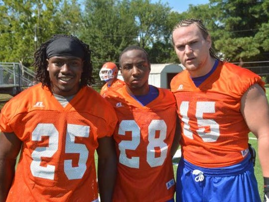 Louisiana College's Aurren Cooksey (left), Brandon Smith and Austin Carlin