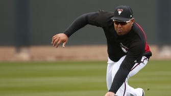 Arizona Diamondbacks left fielder Yasmany Tomas (24) fields a ball during the first day of full-squad spring training workouts at Salt River Fields February 19, 2018.