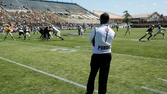 Head coach Darrell Hazell watches his player during