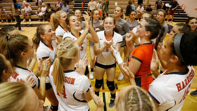 Harrison players celebrate after swepting Frontier 25-13, 25-16, 25-13 Tuesday, August 22, 2017, at Harrison High School.