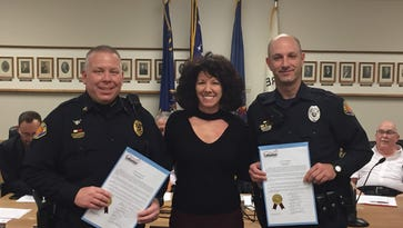 Lebanon Mayor Sherry Capello stands between Lebanon police Sgt. Jeffrie Marley and Patrolman Adam Rusz after recognizing them for their meritorious action in two separate incidents: Marley for preventing a suicide and Rusz for saving a heroin overdose victim.