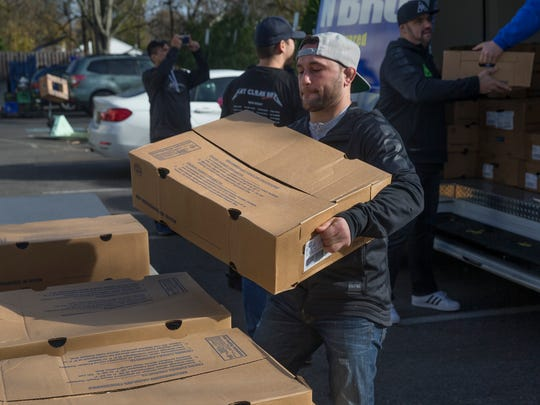 Toms River's Frankie Edgar stacks boxes of Thanksgiving turkeys in Red Bank on Tuesday.