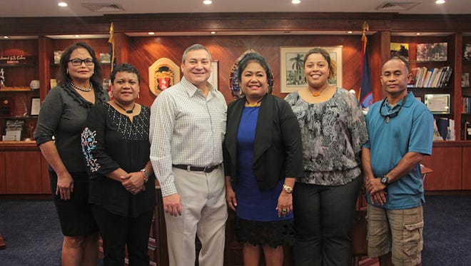 An advance team of the 2016 Festival of Pacific Arts from the Republic of Palau met with Gov. Eddie Calvo (center left) and Festival Director Rose Ramsey (far left) on Oct. 19. The Palau team was lead by ROP's Cultural Affairs Minister Baklai Temengil (second from left), and First Lady Debbie Remengesau (center right).
