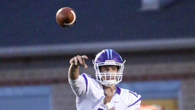 Brownsburg quarterback Hunter Johnson threw for five touchdowns and 302 yards in Friday's 38-25 win over Zionsville.