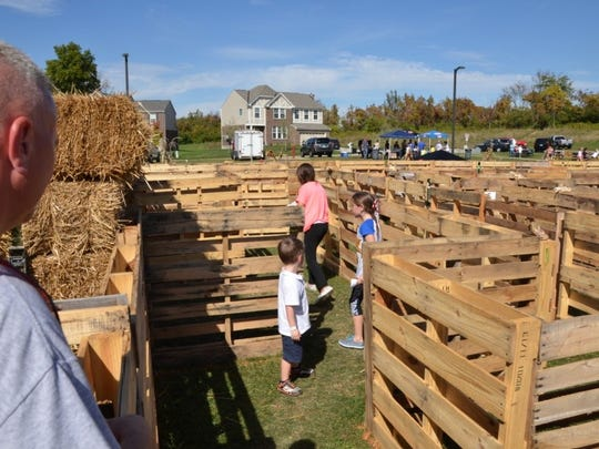 It took three days to build with over 100 volunteer hours invested in the construction but the maze was a hit among festival attendees. Almost 750 people paid to navigate the maze and solve a word puzzle along the way.