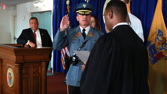 Gov. Chris Christie attends the New Jersey State Police swearing in ceremony of Lt. Colonel Pat Callahan as the new NJSP superintendent by Judge Glenn Grant in Trenton on Tuesday,
