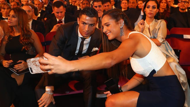 Deyna Castellanos and Cristiano Ronaldo takes a selfie during The Best FIFA Football Awards at The London Palladium on October 23, 2017 in London, England.