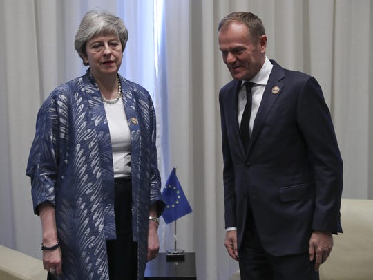 European Union Council President Donald Tusk poses with British Prime Minister Theresa May during a bilateral meeting on the sidelines of a summit of EU and Arab leaders at the Sharm El Sheikh convention center in Sharm El Sheikh, Egypt, Feb. 24, 2019.