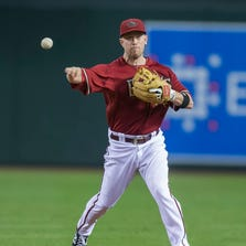 Diamondbacks second baseman Aaron Hill throws out a runner at first against the Rockies at Chase Field on Aug. 9, 2014.