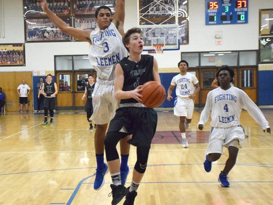 Wilson Memorial's Chance Church goes up for a layup