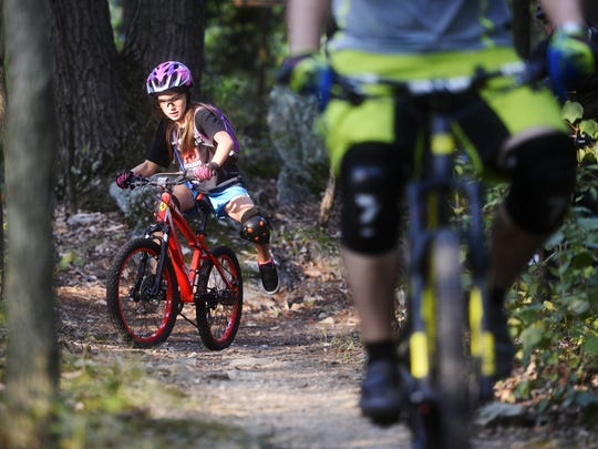 Cassidy Mease, 8, rides a trail at Rocky Ridge County