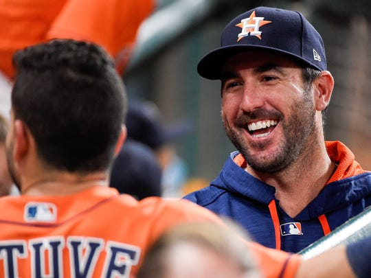 Houston Astros' Justin Verlander, right, laughs while talking to Jose Altuve during the second inning of the second game of a baseball doubleheader against the New York Mets, Saturday, Sept. 2, 2017, in Houston.