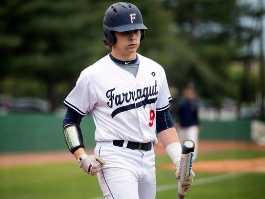 Farragut's Parker Noland returns to the dugout during