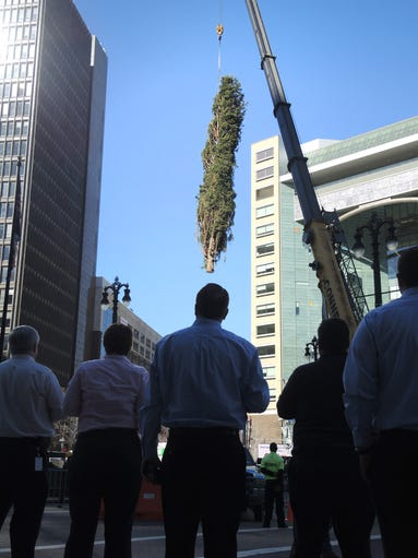 Downtown office workers watch as Detroit's official