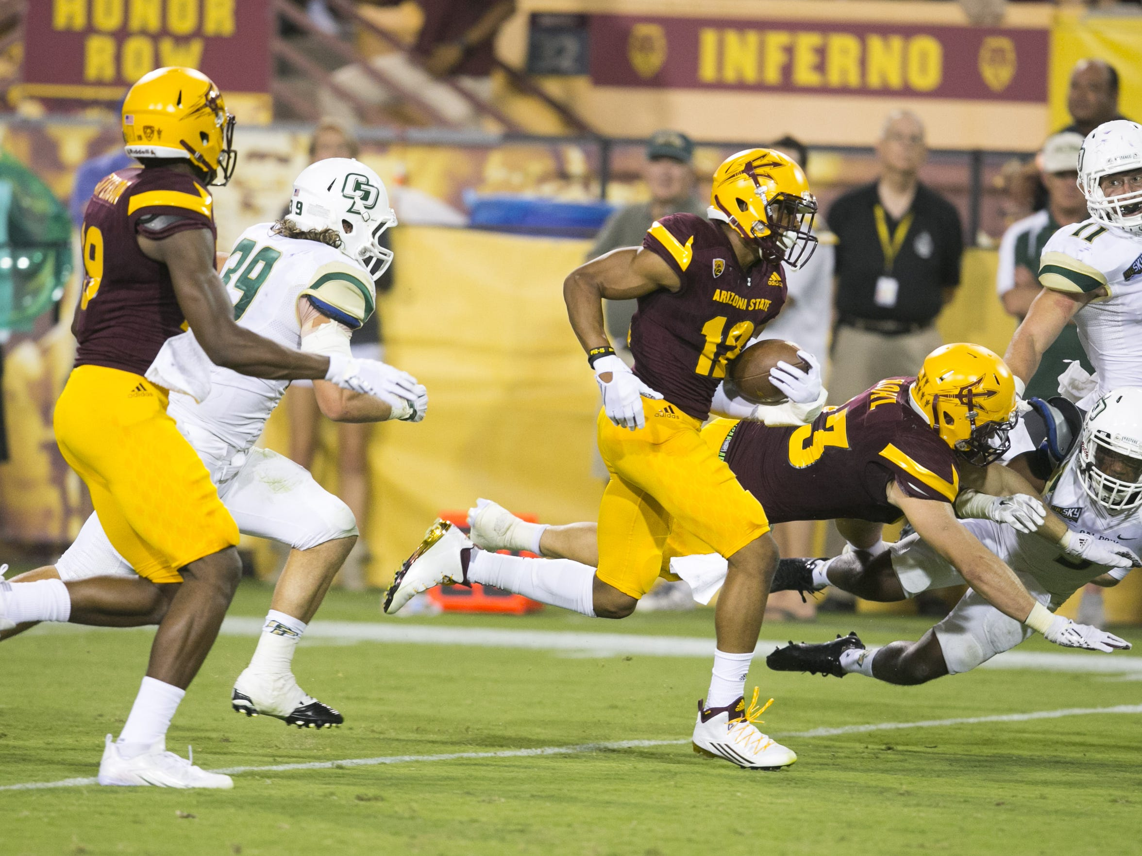 ASU receiver Tim White carries the ball against Cal Poly during the fourth quarter of the college football game at Sun Devil Stadium in Tempe on Saturday, September 12, 2015.