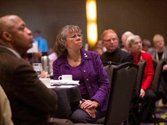 Linda Carter-Lewis of Des Moines listens to speakers Monday, Jan. 19, 2015, during the third annual Dr. Martin Luther King Jr. prayer breakfast at the Community Choice Credit Union Convention Center in Des Moines