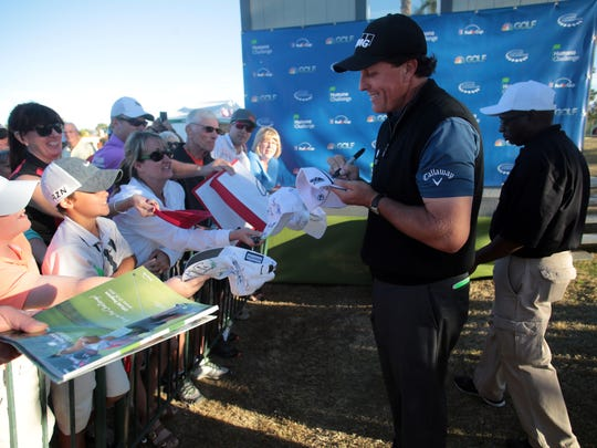 Phil Mickelson sign autographs on the Nicklaus Private Course during the second round of the Humana Challenge on Friday, January 23, 2015 in La Quinta.