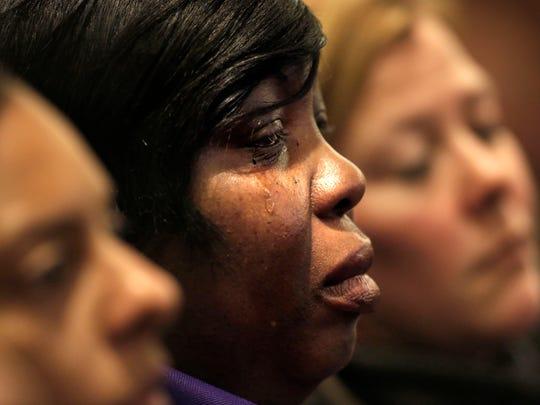 Ursula Ward, center, mother of victim Odin Lloyd, is