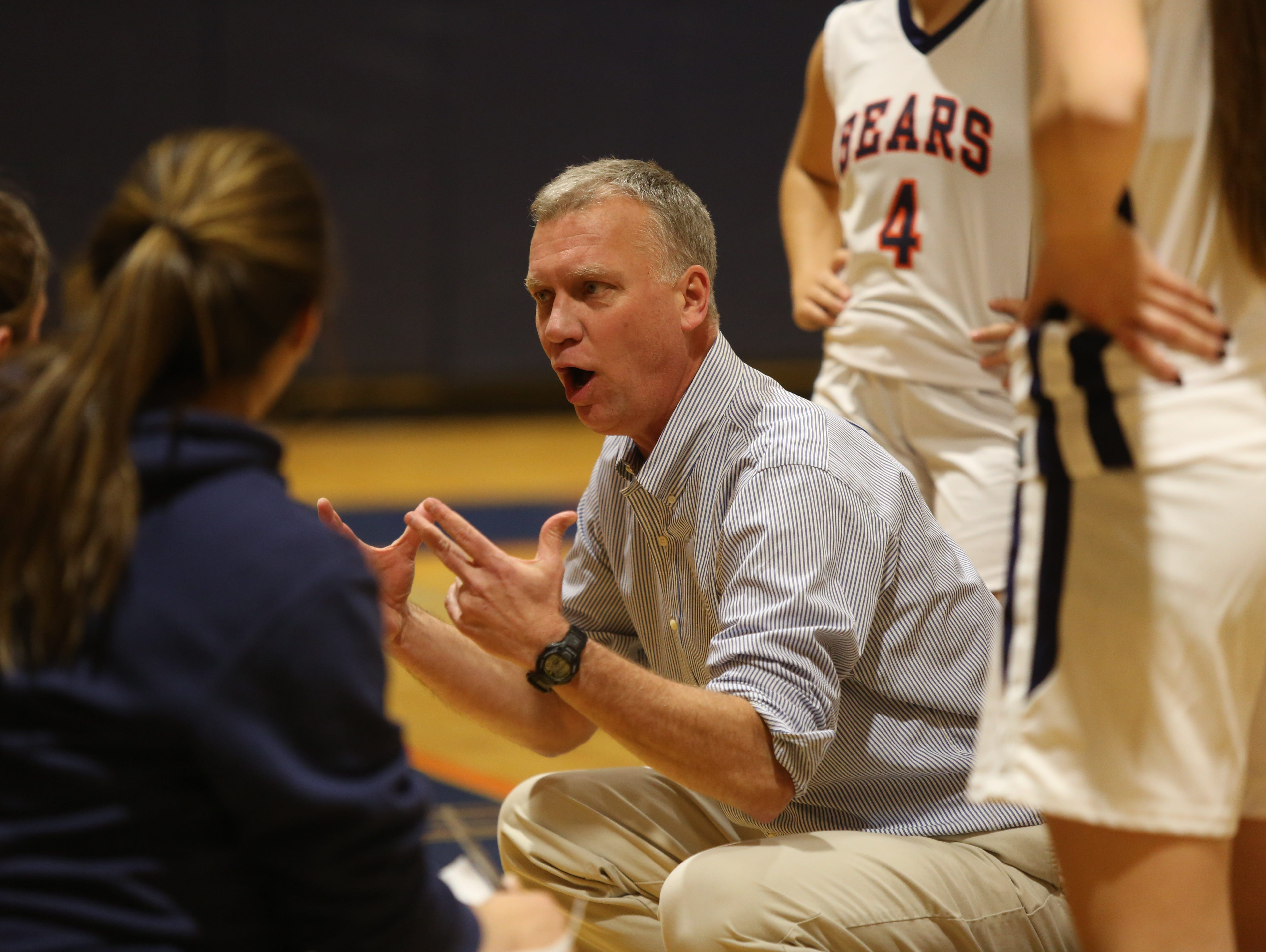 Briarcliff coach Don Hamlin talks to his team during girls basketball game against Pleasantville at Briarcliff High School on Jan. 29, 2015. Pleasantville defeated Briarcliff 40-29.