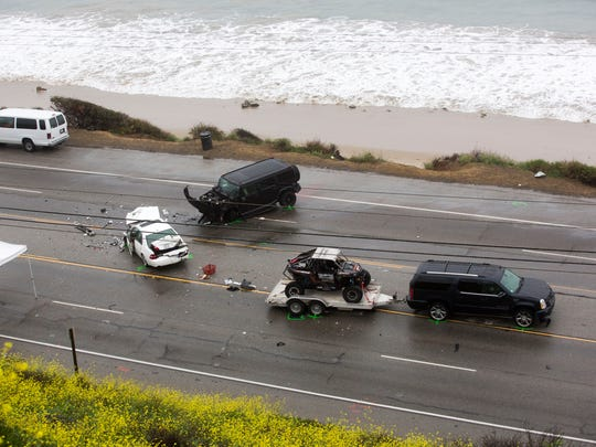 Bruce Jenner's SUV (right) with a trailer is seen at