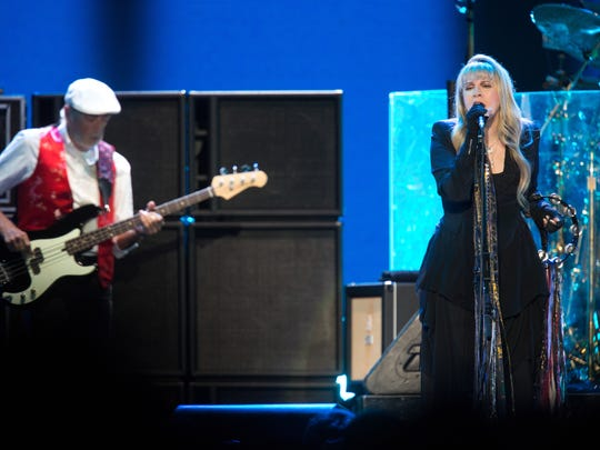 Stevie Nicks and John McVie perform with Fleetwood