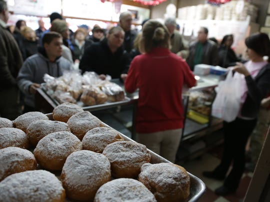 A large crowd of customers wait to purchase paczki at New Palace Bakery in Paczki Day is Tuesday, Feb. 17, 2015.