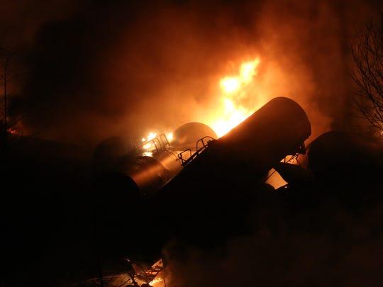 Derailed oil tanker train cars burn near Mount Carbon,