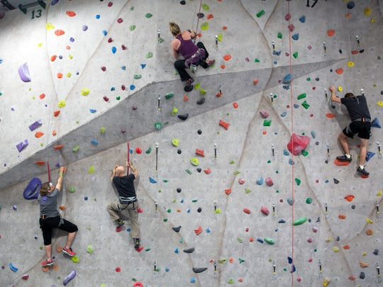 Guests (from left) Joelle Miner, Roger Vasey, Julia Burke and Chad Paulsen climb on Friday, Feb. 20, 2015 during the It Takes Two...On the Rocks fundraiser for ChildServe at Climb Iowa in Grimes.