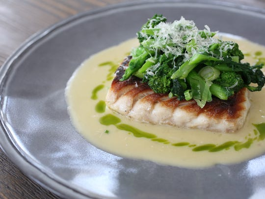Roasted Snapper with garlic broth, broccoli rabe and parsley oil at 121 Restaurant in North Salem, for Hudson Valley Restaurant Week Spring 2015, photographed Feb. 24, 2015.