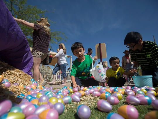 Children hunt for Easter Eggs behind the school house at Rawhide Western Town, Sunday, April 5, 2015, in Chandler.