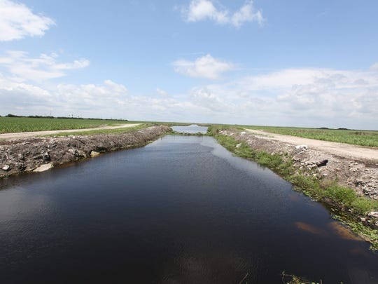 The South Florida Water Management District has an option to buy about 46,000 acres of sugar land by October at an estimated cost of $500 million to $700 million.One proposal is to build a water storage reservoir on the 26,000 acres that is south of Lake Okeechobee, but state representatives and the water management district have been hesitant to pull the trigger on the deal. The company doesnÕt want to sell the land, which has been under contract since former Gov. Charlie Crist proposed buying all of U.S. Sugar and its assets in 2008.