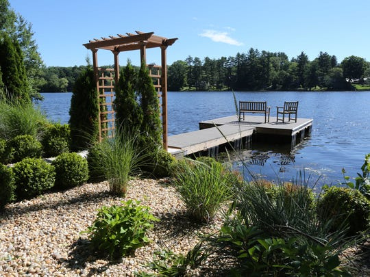 A well-planted swale at lake's edge helps catch and filter rainwater runoff from the roof and driveway.