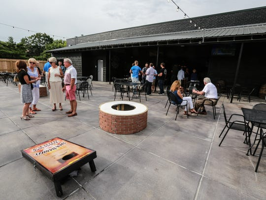 The outdoor patio at Blind Owl Brewery offers two fire pits, TVs, cornhole and bocce.