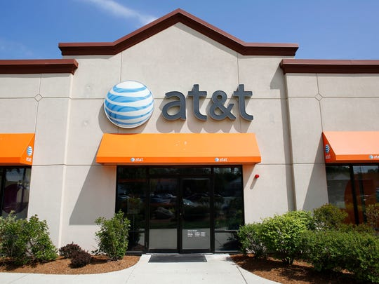 In this Wednesday, May 14, 2014 photo an AT&T logo