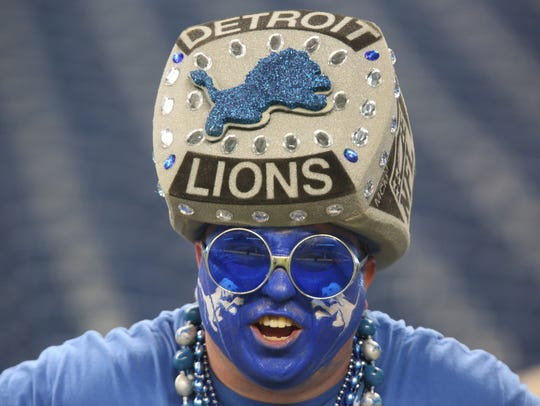 Detroit Lions fan Ward Elliot of Livonia yells out